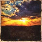 sun-falling-thru-clouds